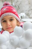 Girl with snowballs Stock Photography