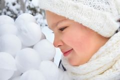 Girl with snowballs Stock Image