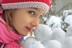 Girl with snowballs Royalty Free Stock Photos