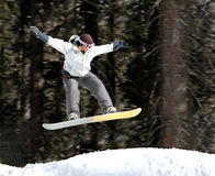 Girl on a snowboard. Girl jumping on a snowboard stock photo