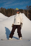 Girl on snowboard. A young woman on a snowboard royalty free stock photo