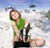 Girl with snowboard Boots Royalty Free Stock Images