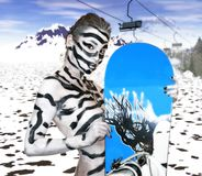 Girl with snowboard Boots stock photos