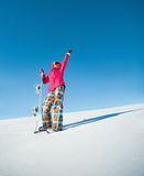 Girl with snowboard on the snow Royalty Free Stock Photography