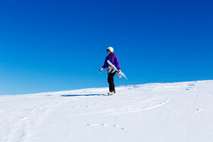 Girl with snowboard at the top of a mountain Royalty Free Stock Images