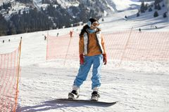 Girl snowboarder Stock Image