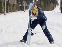 Girl snowboarder stock image