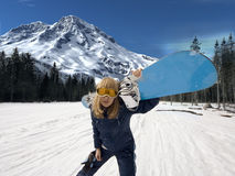 Girl - snowboarder. The girl - snowboarder on snow slope photo Stock Images