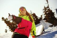 Girl snowboarder enjoys the ski resort Stock Photos
