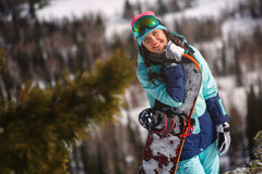 Girl snowboarder enjoys the ski resort Royalty Free Stock Image