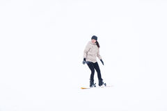 The girl snowboarder in green overalls Royalty Free Stock Images