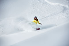 Girl snowboarder off-piste backcountry freeriding. Girl snowboarder freeriding at off-piste ski slope. Backcountry ski photo Royalty Free Stock Images
