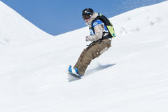Girl snowboarder rides steep mountains. Kamchatka, Far East, Russian Federation Stock Photography