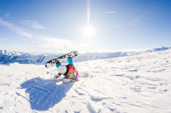Girl snowboarder taking some rest Royalty Free Stock Photo