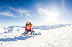 Girl snowboarder taking some rest Royalty Free Stock Photography
