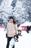 The girl snowboarder in the winter wood Stock Image