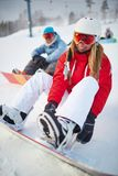 Girl snowboarding. Young snowboarder in winter activewear on vacations Royalty Free Stock Photo