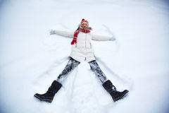 Girl in snowdrift Royalty Free Stock Photos