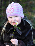 Girl with snowdrop Stock Photos