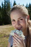 The girl with the snowdrops. Smiling girl holding a bouquet of snowdrops sunny spring day Stock Photography