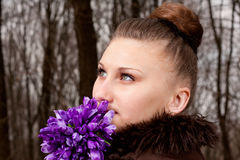 Girl with snowdrops Stock Photography