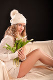 Girl and snowdrops Royalty Free Stock Image