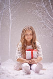 Girl in snowfall Stock Images