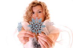 Girl and snowflake Royalty Free Stock Photo