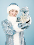 Girl with snowflake Royalty Free Stock Photography
