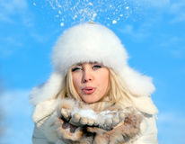 Girl with snowflake. Attractive, beautiful girl with snowflake Stock Images