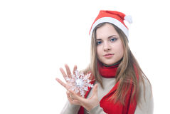 Girl with the snowflake in her hand. Portrait of girl with the toy snowflake in her hand isolated on white Royalty Free Stock Photography