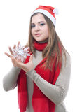 Girl with the snowflake in her hand. Portrait of girl with the toy snowflake in her hand isolated on white Royalty Free Stock Images