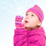 Girl and snowflakes. Young girl and flying snowflakes Stock Images