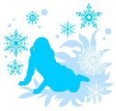 Girl and snowflakes. Sitting girl silhouette on a blue  background with snowflakes Stock Images