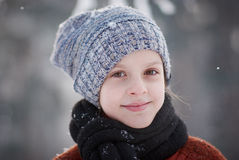 Girl and snowflakes Stock Image