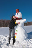 The girl and the snowman Royalty Free Stock Image