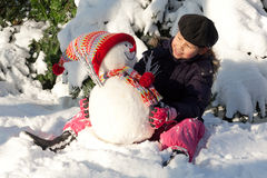 Girl with snowman Stock Photography