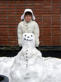 Girl and snowman Stock Photography