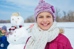 Girl with a snowman Stock Photography