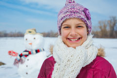 Girl with a snowman Royalty Free Stock Photo