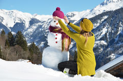 Girl and snowman Royalty Free Stock Photography