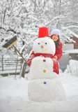 Girl with snowman Stock Image