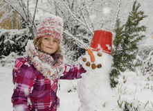 Girl with snowman Royalty Free Stock Photos