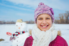 Girl with a snowman Royalty Free Stock Image