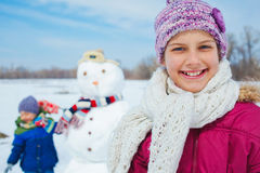 Girl with a snowman Royalty Free Stock Photos