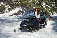 Girl on snowmobile Royalty Free Stock Photos