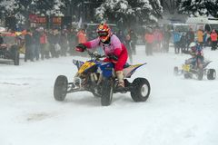 Girl on a snowmobile stock images