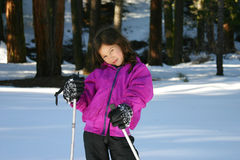 Girl in snowshoes Royalty Free Stock Photo