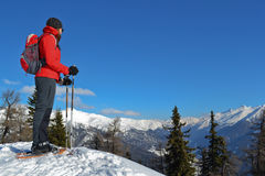 Girl with snowshoes. In the mountains Stock Image