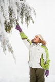 Girl and snowy branches Royalty Free Stock Photos
